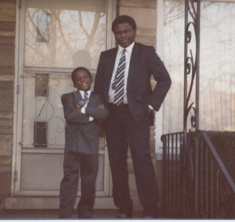 "Ayodeji with his father, Abimbola ""Yinka"" Ogunniyi, at home after church in 1993. Photo courtesy of Ayodeji Ogunniyi."